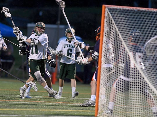 Drew Snelbaker of York Catholic takes a shot on goal against Hershey during the District 3 Class 2-A quarterfinal lacrosse match last week. John A. Pavoncello photo
