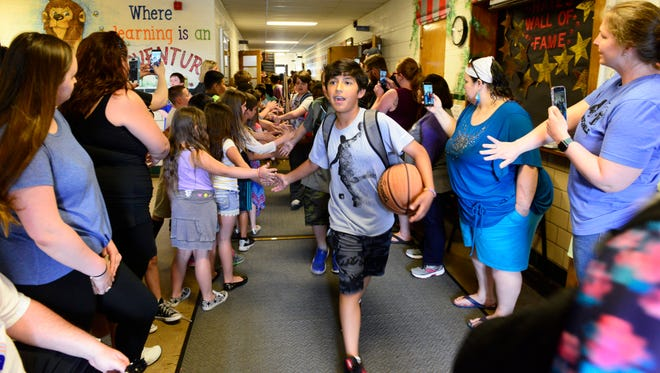 Fifth grade student Issac Sanchez leads the class of 2025 out of Hayes Elementary on the last day of school on Tuesday afternoon. The Fremont City Schools board of education has made minor changes to the dress code for the coming school year.