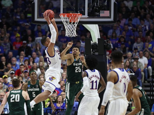 Kansas Jayhawks forward Landen Lucas goes over Michigan State Spartans forward Kenny Goins (25) during the second half of MSU's 90-70 loss in the second round of the 2017 NCAA tournament at BOK Center on March 19, 2017 in Tulsa, Okla.
