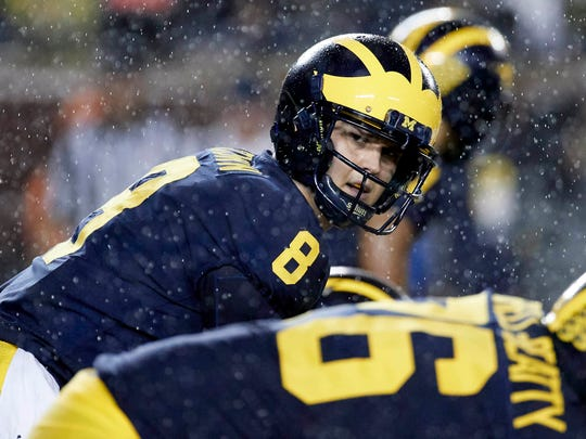 Oct 7, 2017; Ann Arbor, MI, USA; Michigan quarterback John O'Korn gets set to run a play in the second half against Michigan State at Michigan Stadium.