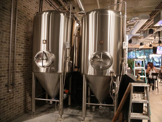 Pedal Haus Brewery's steel tanks are part of the decor