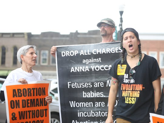 Adrienne Luendo, second from right, protests against the attempted murder charge against Murfreesboro resident Anna Yocca outside the Rutherford County Judicial Building on Tuesday morning.