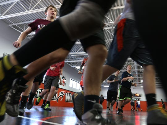 The Stratford wrestling team warms up during practice