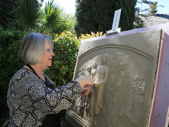 St. George artist Annette Everett scupts Thursday during