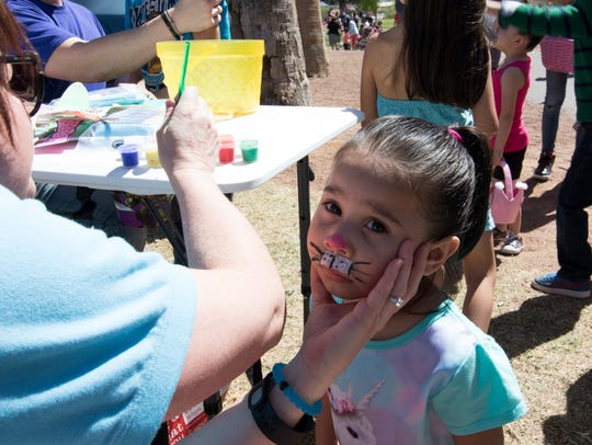 Myra gets her face painted at the Springfest event