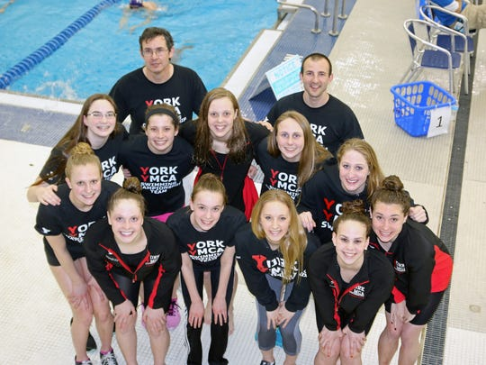 The York YMCA women's swim team won the national title at YMCA Short Course Nationals held April 4-8 in Greensboro, N.C. Pictured from left are, front row: Marisa Gingerich, Emily Ilgenfritz, Riley Trout, Cami Cook, Kacey Oberlander and Courtney Harnish; middle row:  Callie Paff, Julia Pokrzywa, Leah Braswell, Megan Hunt and Meghan Small; and back row: coach Michael Brooks and coach John Nelson.