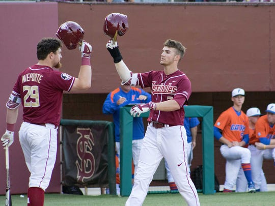 Lueck celebrates after his first career home run against