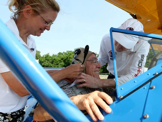 WWII veteran John Boucher, 88, is assisted by pilot Mike Winterboer and Diane Winterboer with Ageless Aviation Dreams Foundation, as they prepare to take off  in a 1942 Stearman. Seniors from the Spring Hills Senior Assisted Living Facility had the opportunity to fly in a 1940's Boeing Stearman, open cockpit biplane.  The event was sponsored by the Ageless Aviation Dreams Foundation and the event was held at the Central Jersey Regional Airport in Hillsborough Sunday.