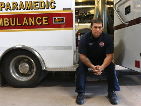 Ron Heibler, a paramedic in Stevens Point, sits outside an ambulance at the station in Stevens Point, September 20, 2016.