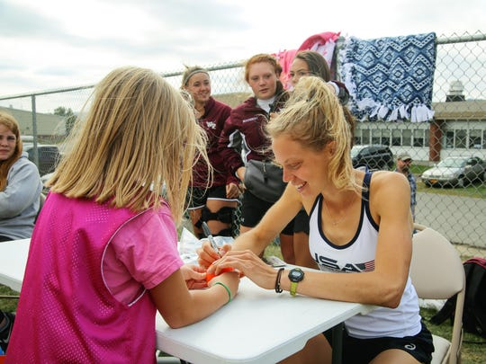 Alesha Widdall, a Whitney Point graduate and an Olympic alternate for the USA Field Hockey team, showed up to the Whitney Point Youth Club Field Hockey home tournament on Sept. 17 to greet the children and sign autographs.