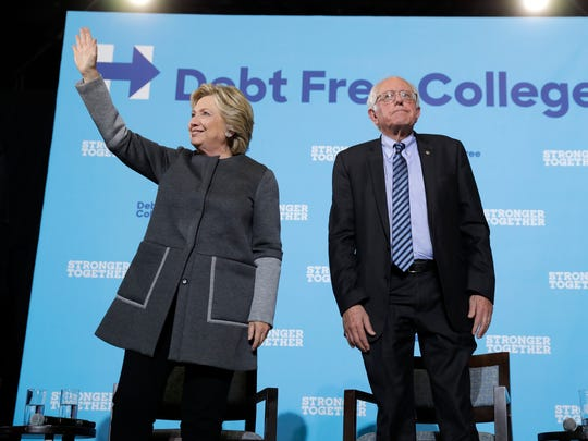 Hillary Clinton and Bernie Sanders make a campaign