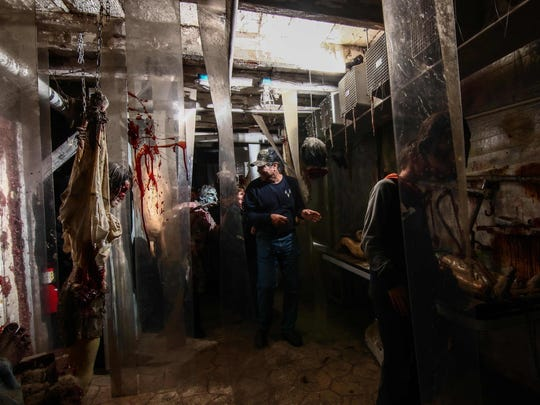 Guests move through a haunted house attraction at Frightland in Middletown in 2016.