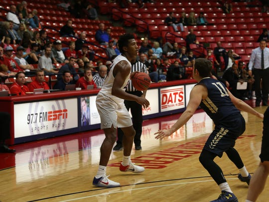 Dixie State's Trevor Hill looks to pass during a game against NDNU Saturday at the Burns Arena. Hill scored just 10 points, but dished out a team-high seven assists in DSU's 77-69 victory.
