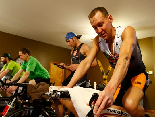 Chad Esker, of Mosinee, trains on his bicycle along