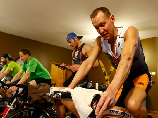 Chad Esker, of Mosinee, trains on his bicycle along with his friends as part of his triathlon training Friday, February 3, 2017, at his house.