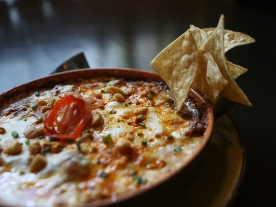 Chorizo and manchego fundido with hot, melted manchego