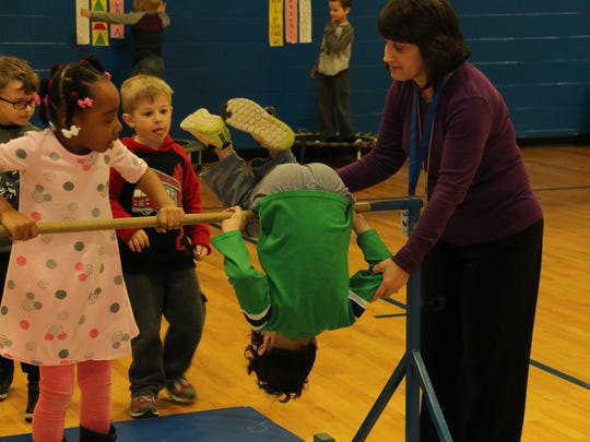David Youree physical education teachers said use of the inversion bars help get kindergarten students' day off to a good start.