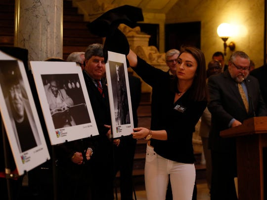 Alyssa Rose, administrative assistant with The Mississippi Arts + Entertainment Experience (The MAX), unveils the inaugural Hall of Fame class of 18 Mississippians at the Capitol Thursday.