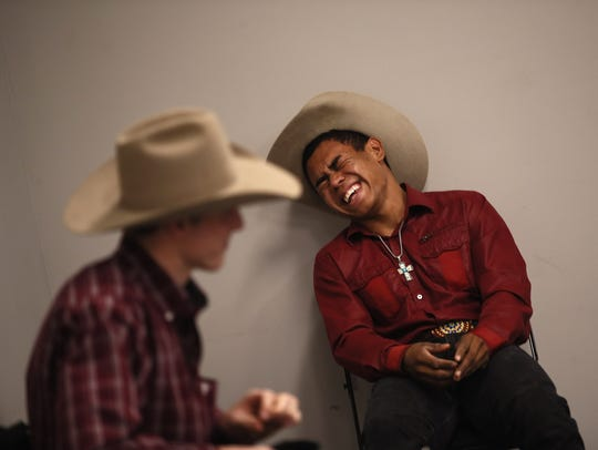 Keyshawn Whitehorse laughs in the locker room before