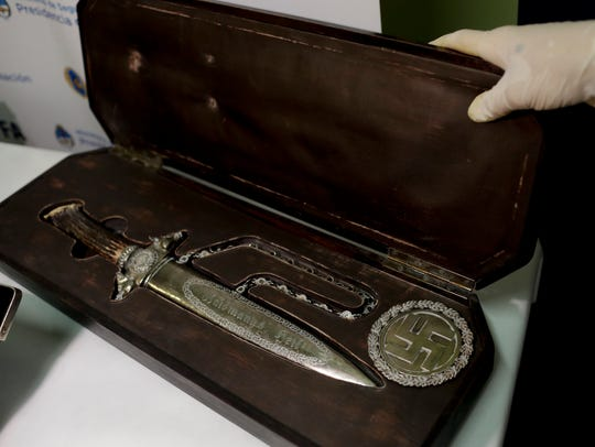 A knife with Nazi markings is seen at the Interpol