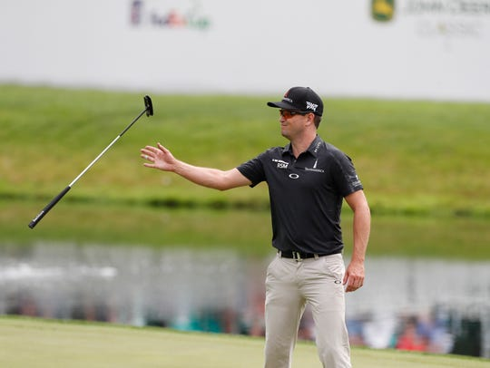 Zach Johnson catches his putter on the 18th green as
