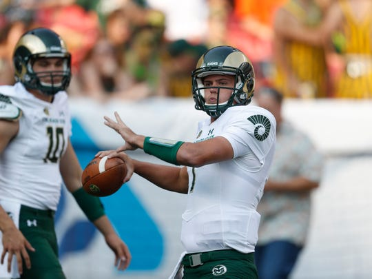 Colorado State Rams quarterback Nick Stevens (7) warms up before the first half of an NCAA college football game Friday, Sept. 1, 2017, in Denver.