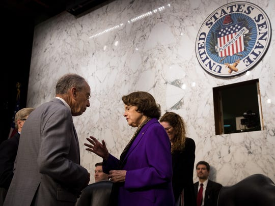 Senate Judiciary Chairman Chuck Grassley speaks with ranking member Dianne Feinstein before the start of a July 27, 2017, hearing on Capitol Hill.