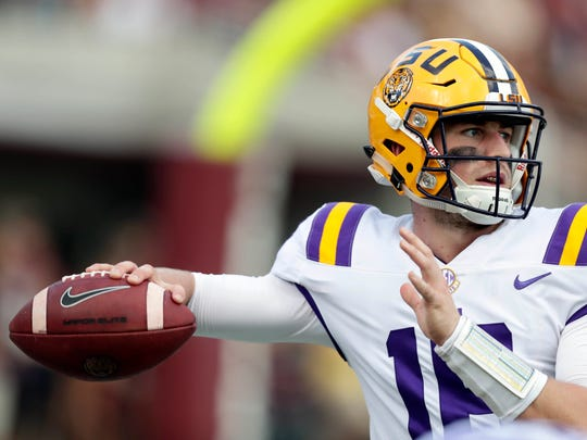 LSU quarterback Danny Etling (16) readies to pass during