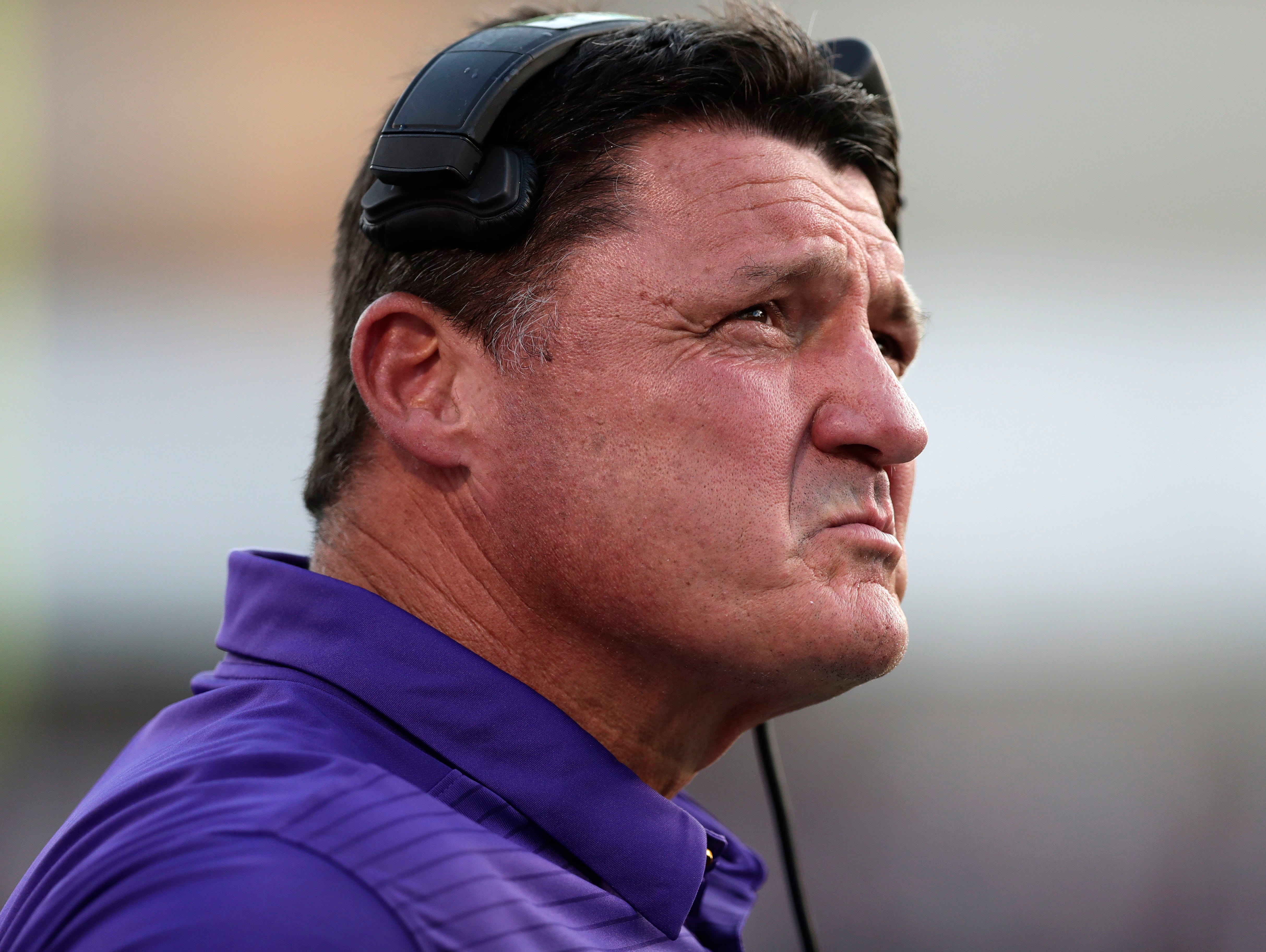 LSU head coach Ed Orgeron looks at a replay on the end zone screen during the first half of their NCAA college football game against Mississippi State in Starkville, Miss., Saturday, Sept. 16, 2017.