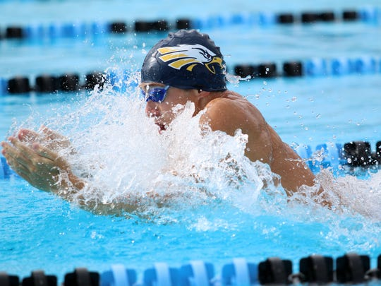 Naples' Matthew Limbacher comes up for air while swimming the breast stroke portion of the boys 200 yard medley relay at the Collier County Athletic Conference swimming and diving championships at Norris Pool in Naples, Florida on Saturday, Oct. 7, 2017.