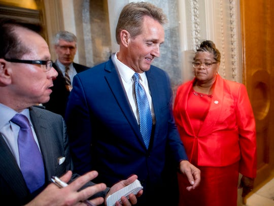 Sen. Jeff Flake, R-Ariz., walks onto the Senate floor