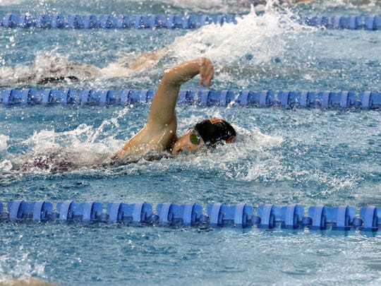Elise Nishii-Kim of Ithaca swims in the 200-yard freestyle preliminaries Friday at the New York State Girls Swimming and Diving Championships at Ithaca College.