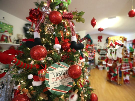 Decorations fill the store at the Havana Christmas Tree Farm on Friday, Dec. 1, 2017.