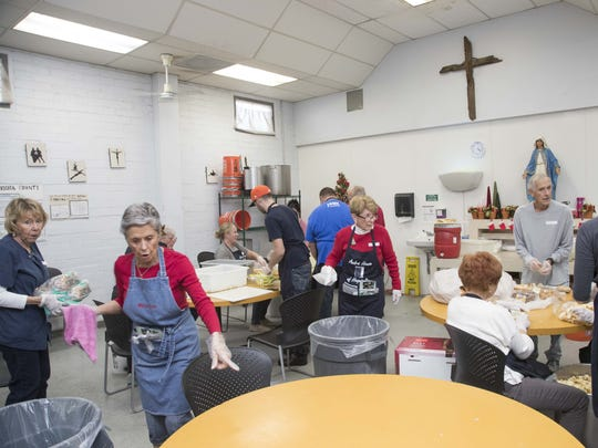 Volunteers prepare an evening meal at Andre House.