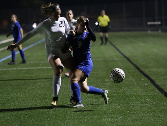 Madison Adragna (20) and Alyssa Pilavis (9) during a rivalry game between Barron Collier and Gulf Coast on Thursday.
