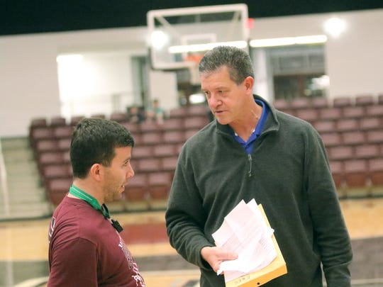 Michael Seger and assistant Jon Ginn discuss East Webster's upcoming against Leflore County game before practice.