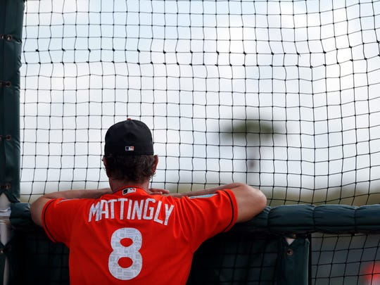 Feb. 18: Marlins manager Don Mattingly watches from behind the batting cage.