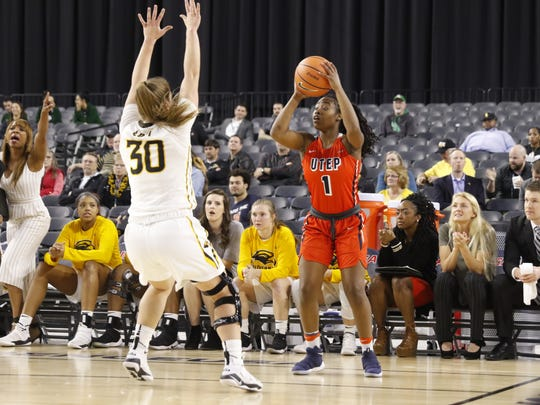 UTEP's Roeshona Patterson feels the pressure from a Southern Mississippi defender March 7 in Frisco during the Conference USA tournament.