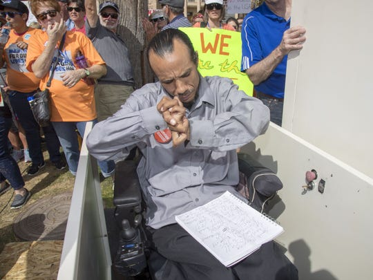 James Wade Hinckley, who was shot in 1991 by a 16-year-old in Phoenix, prepares to speak in front of thousands of Valley residents at the March For Our Lives at the Arizona State Capitol on Saturday, March 24, 2018.