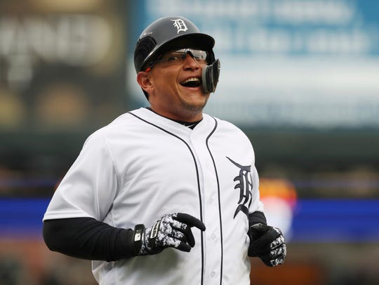 Tigers' Miguel Cabrera smiles after scoring during