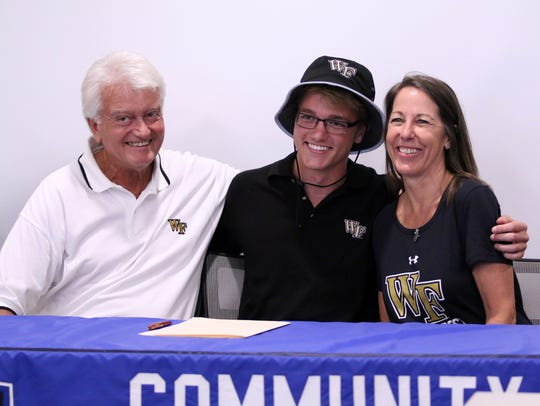 Pole vaulter Kane Aldrich signs his letter of intent