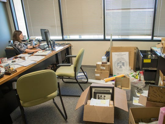 Erin Schneiderman, director of special events, has her boxes ready to move from ASU's Thunderbird School of Global Management in Glendale to downtown Phoenix.