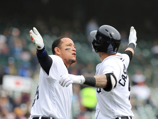 Detroit Tigers' Nicholas Castellanos is congratulated by Miguel Cabrera after they both scored on Castellanos' two-run home run during the third inning against the Kansas City Royals, Saturday, April 21, 2018 in Detroit.