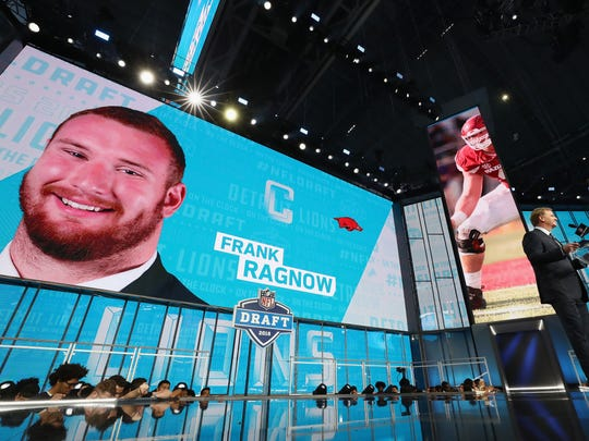 A video board displays an image of Frank Ragnow, after he was picked 20th overall by the Detroit Lions during the first round of the 2018 NFL Draft at AT&T Stadium on April 26, 2018 in Arlington, Texas.