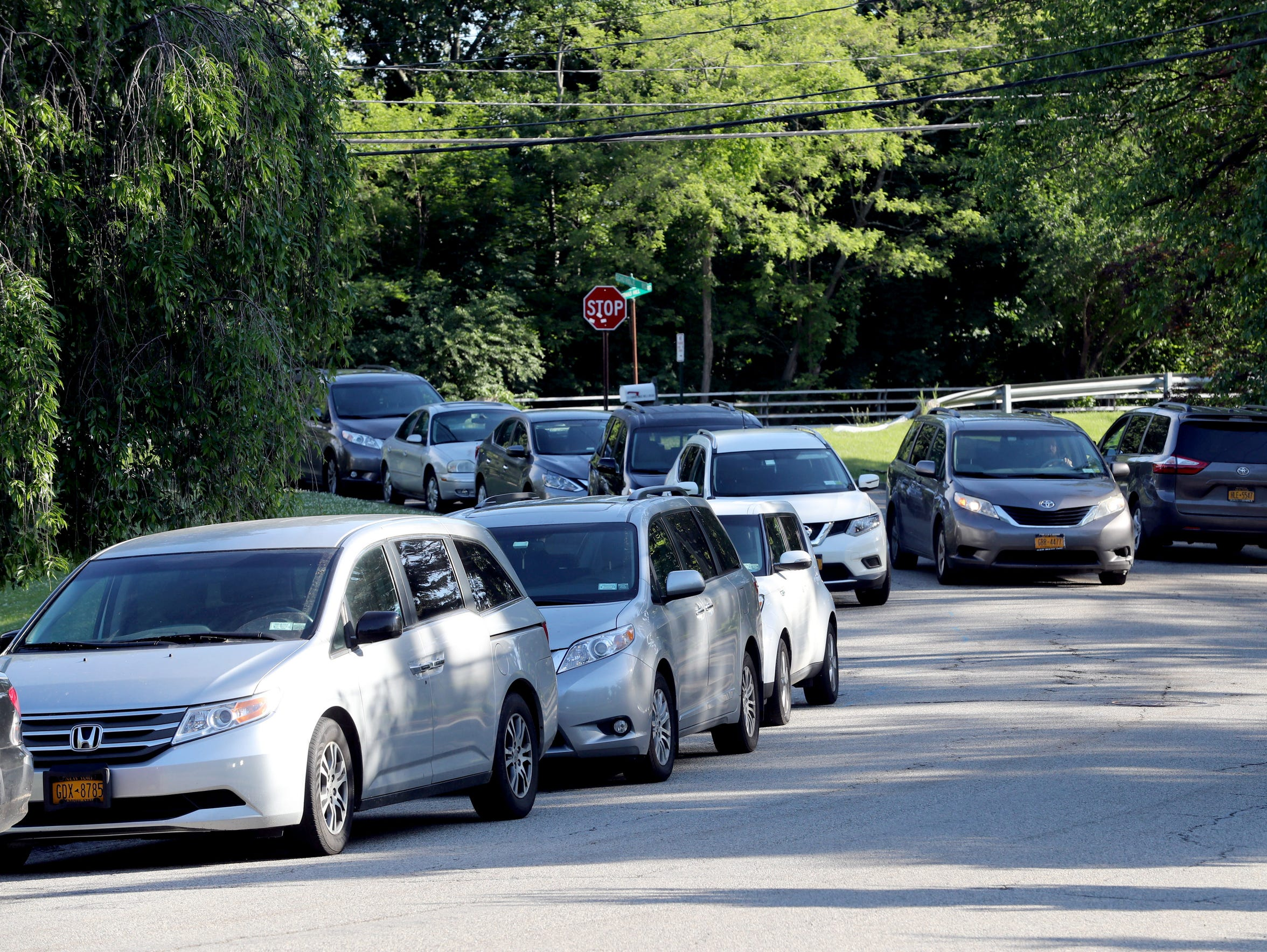 Cars pass each other on Echo Ridge Road in Airmont,