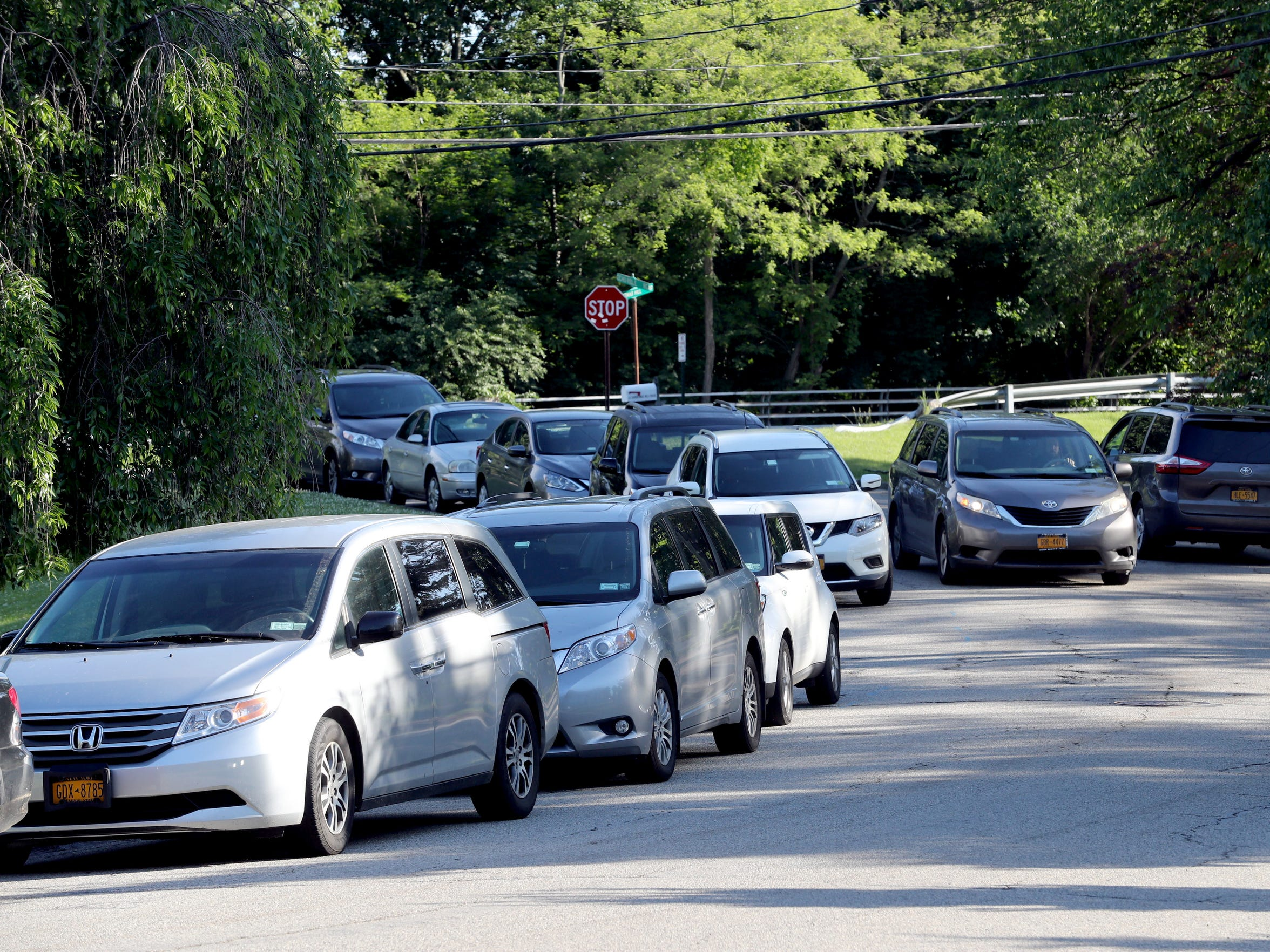 Cars pass each other on Echo Ridge Road in Airmont, across from Bais Hamedrash Radashitz, an Orthodox synagogue, during the morning hours of June 5, 2018. Congregants of the synagogue park on the street when the parking lot at the synagogue is filled during morning worship six days a week.