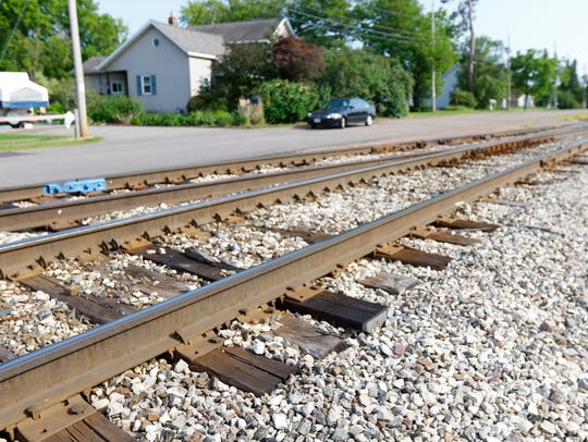 A railroad track runs near Diane Neumann's property