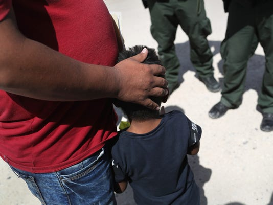 Border Patrol Agents Detain Migrants Near US-Mexico Border