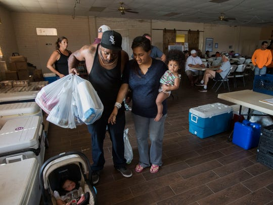 A family from Anza receives food and supplies at the Anza Community Center.