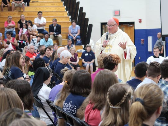 Cardinal Timothy Dolan speaks to the audience Saturday